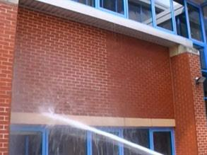 Demonstration of the water-repellent properties of Belzona 5122 (Clear Cladding Concentrate) on the left side of the wall